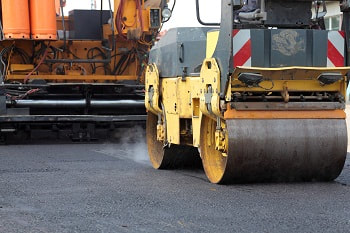 heavy equipment needed for asphalt parking lot paving